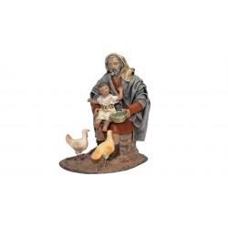 Pastor con niño echando comida (95526-529) - 12 cm