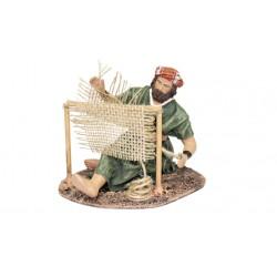 Pastor cosiendo sacos (95582-585) - 12 cm